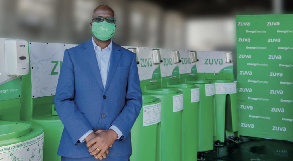 Zuva Petroleum's Chief Executive Officer Mr Gumbo with the Handwashing basins