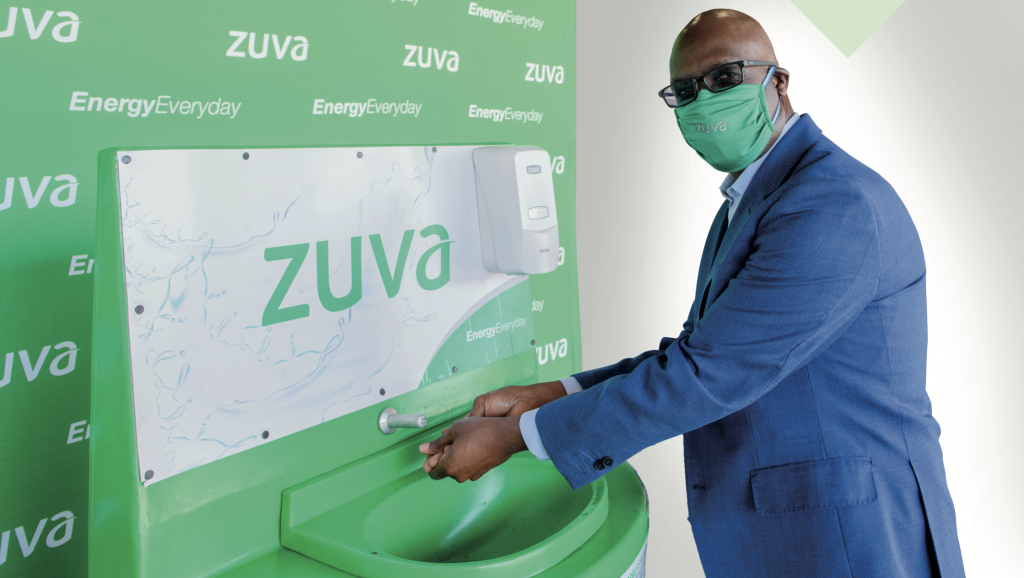 Zuva Petroleum Chief Executive Officer Mr Bethwell Gumbo demonstrates use of the hand-washing station.