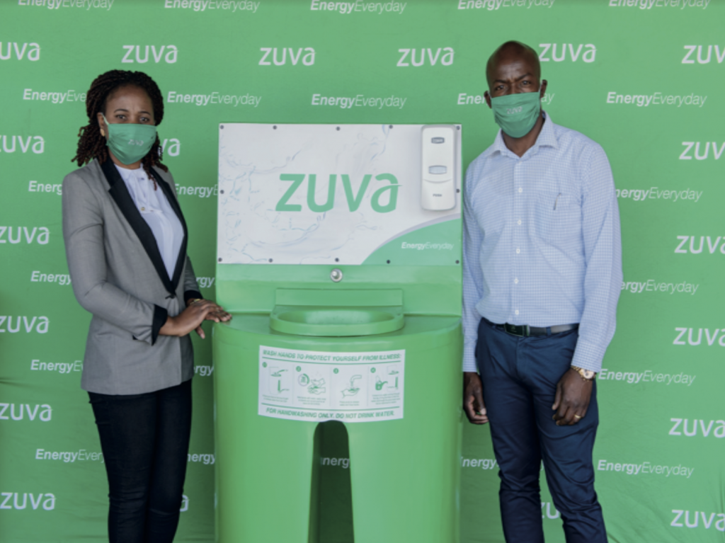 Retail Manager Mrs S Matinya hands over a Hand washing Station to Mr A Shonhiwa Dealer at Zuva Sherwood Service station
