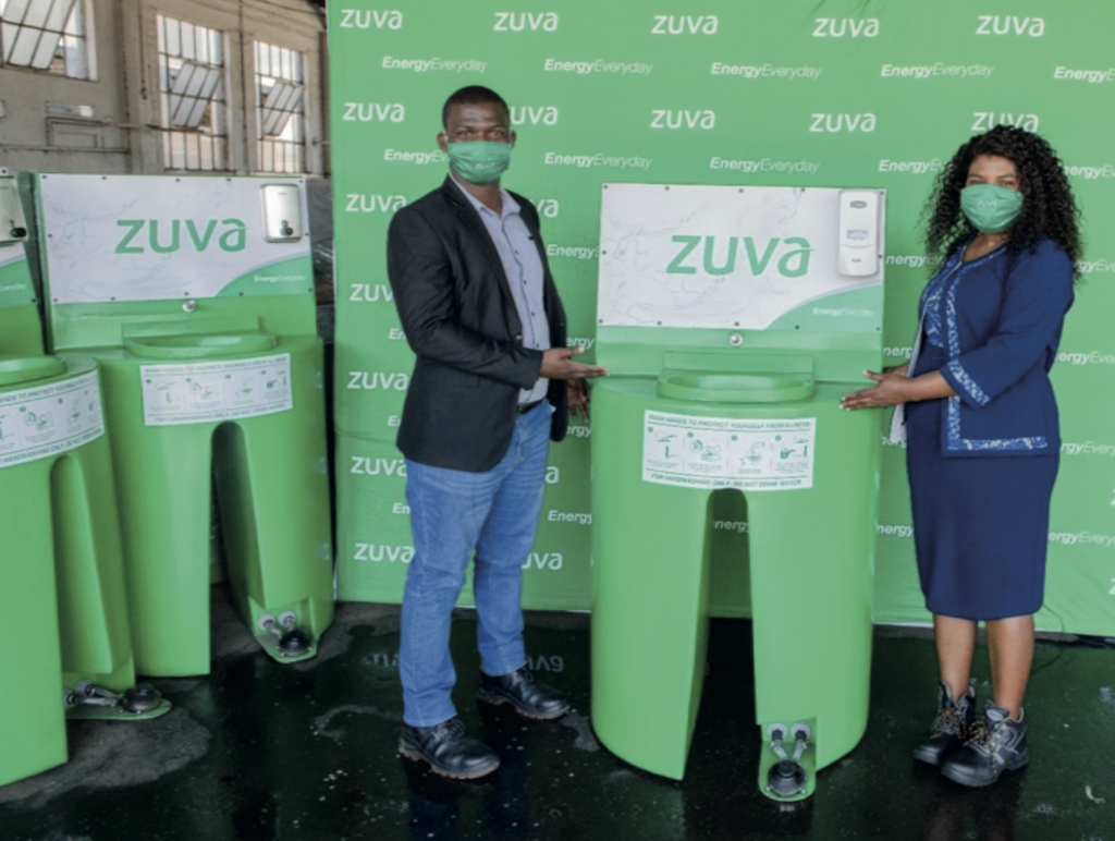 Commercial Manager Mr M Ndlovu hands over a Hand washing Station to Mrs Nyaruviro LPG Reseller at Zuva Gas Westlea