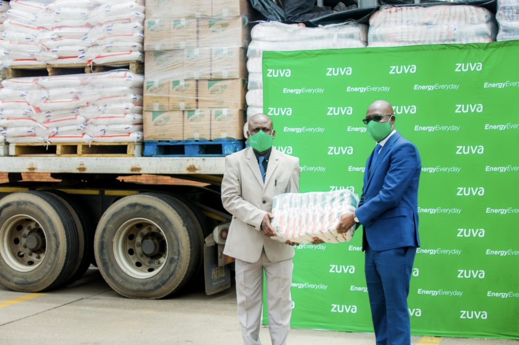Mr B. Gumbo Zuva Petroleum CEO hands over food hampers and PPE to the Chief Director in the Ministry of Public Service Labour and Social welfare Mr C. Matorera